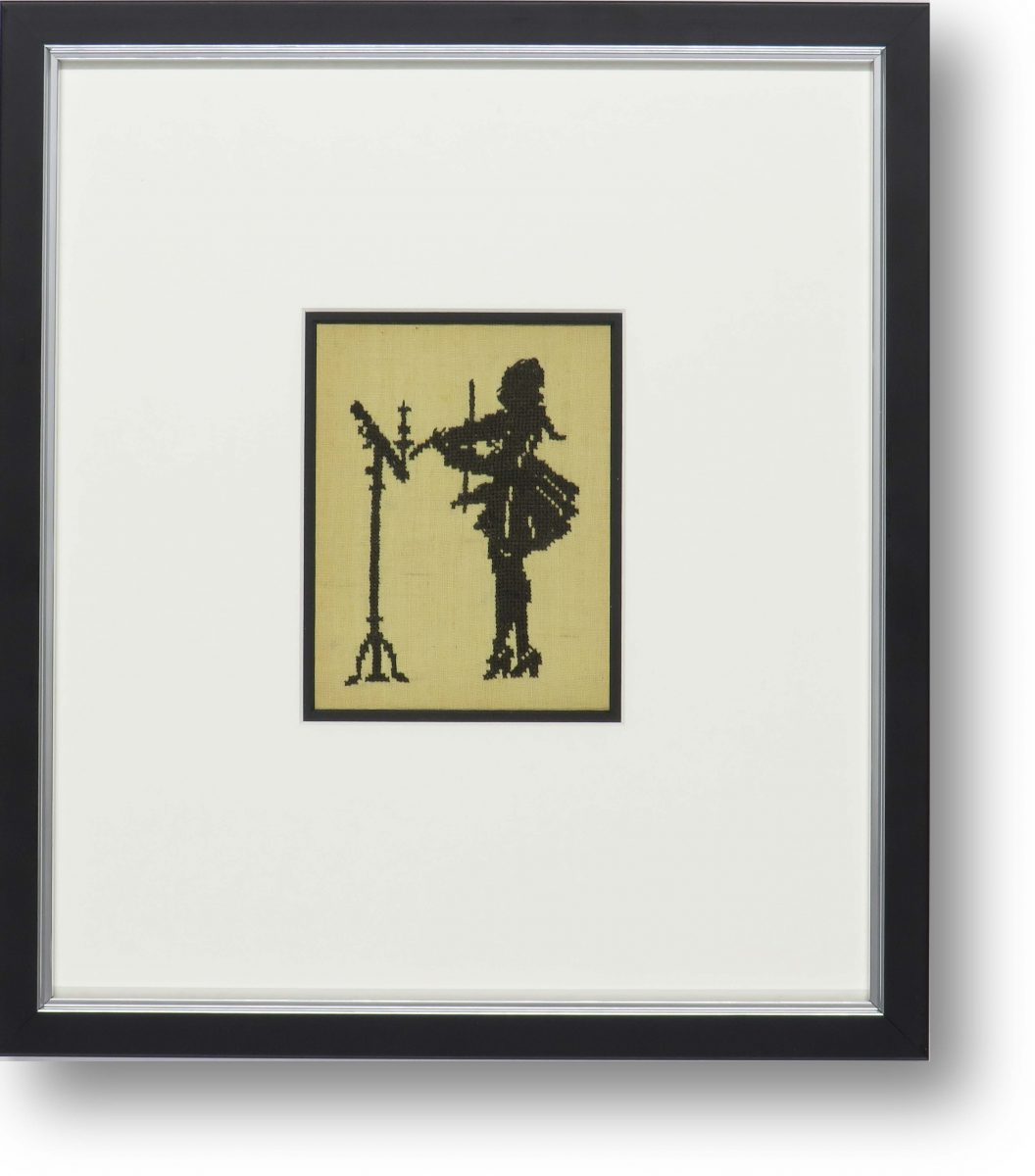 A silhouette in a very simple, stylish black frame